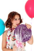 Beautiful woman with lollypop, balloons. Stock Photos