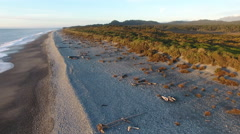 Aerial view of Gillespies Beach and the Southern Alps, New Zealand Stock Footage