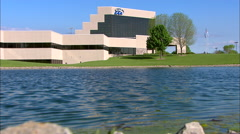 EAA Oshkosh Headquarters Building Water Low Angle Stock Footage