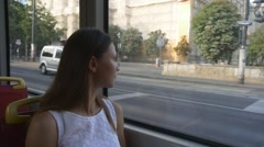 Woman looks out the window of tram Stock Footage