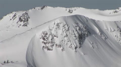 Long-shot of snow-covered rugged mountains. Stock Footage