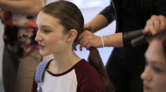 In model schools young female is waiting for hair done Stock Footage