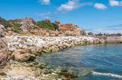 Multi-colored rocks at the harbor in Kleinmond. Stock Photos