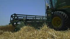 Harvesting of wheat. Plow mower harvester closeup Stock Footage