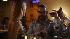 Sexy young couple meet flirting at glamorous party drinking wine in love having Stock Footage