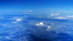 Beautiful clouds through an airplane window - LR Pan Stock Footage