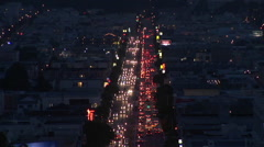 Birds eye-shot of traffic moving in a large city at night. Stock Footage