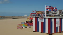 Flags flying on the breezy Margate Main Sands Beach Stock Footage