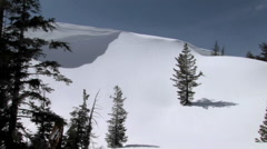 Long shot of a snowboarder on a pristine mountain slope. Stock Footage