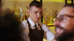 Active night. Young bartender at work, take orders, make cocktails at modern bar Stock Footage
