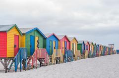 Multi-colored beach huts at Muizenberg. Stock Photos