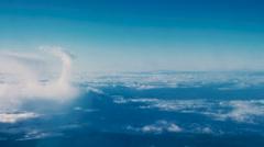 Beautiful clouds through an airplane window (LR Pan, No 1) Stock Footage