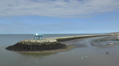 Man-made Tide Barrier with Coastguard Lookout Tower Stock Footage