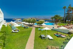 AGIOS NIKOLAOS, GREECE - JULY 30, 2012:  Tourists taking sun bath in hotel Stock Photos