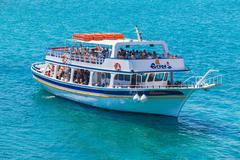 AGIOS NIKOLAOS, GREECE - JULY 31, 2012:  Cruise boat with tourists during tri Stock Photos