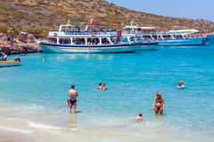 AGIOS NIKOLAOS, GREECE - JULY 31, 2012:  Cruise boat with tourists during tri Stock Photos