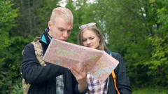 Couple quarelling with each other while reading the map Stock Footage