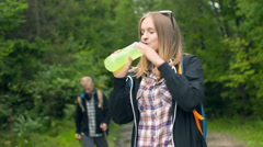 Boy walking with sticks and his girlfriend drinking energy drink, steadycam shot Stock Footage