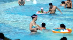 Mid Autumn Festival holiday, people swimming in the swimming pool Stock Footage