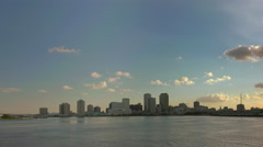 New Orleans skyline seen at sunset from distance Stock Footage