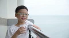 Boy drinking a glass of milk Stock Footage