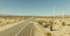 AERIAL: Desert Road & Windmills Spinning Stock Footage