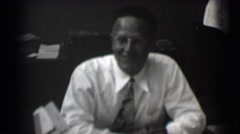 1959: a well dressed man in a tie and eyeglasses with a short hair cut ST. LOUIS Stock Footage