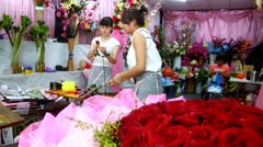 Chinese young women picking rose petals Stock Footage