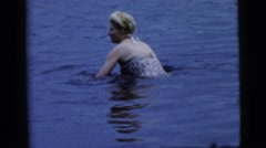 1961: women hopping in shallow water of a large body of water CAMDEN, NEW JERSEY Stock Footage