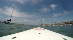 Looking forward from standup paddle board in mooring field by Balboa Island C Stock Footage