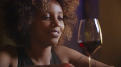 Close up beautiful sexy young black fancy woman drinking red wine in bar Stock Footage