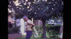 1961: man passes boy while putting on shirt and entering house TOLEDO, OHIO Stock Footage