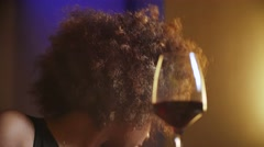 Close up beautiful sexy young black fancy woman boring and drinking red wine in Stock Footage