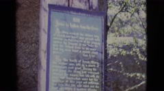 1965: a plaque sits on a marble wall near tree branches at daytime TOLEDO, OHIO Stock Footage