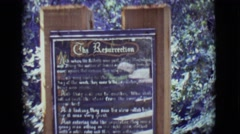 1965: statue of mary with plaque about the resurrection TOLEDO, OHIO Stock Footage