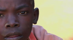 Close-up shot of a beautiful young child in Africa. Stock Footage