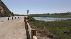Small road bike path by back bay a California estuary. Stock Footage
