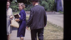 1966: a man and woman awkwardly pose for the camera as if it were a still Stock Footage