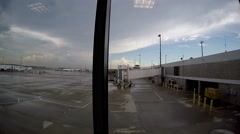 Airport gate in rainy weather viewed from moving sidwalk. Stock Footage