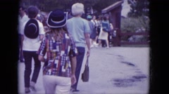 1966: visitors to the park sport their fair weather clothing  Stock Footage