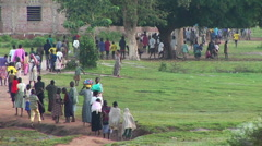 Long-shot of African children run down a country road. Stock Footage