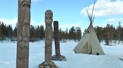 Next to the Sami tent are wooden idols. Stock Footage