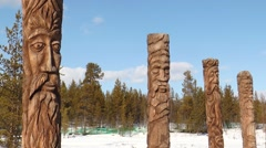 Mysterious Sami idols standing in the woods on a spring day. Stock Footage