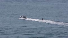 Water skier in the open ocean off Corona Del Mar tracking shot. Stock Footage