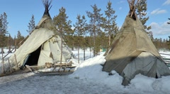 Three of the Saami (Lapp, Laplander) tent in the winter forest. Stock Footage
