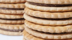 Many sandwich cookies on pile close-up details slow tilt 4K 2160p 30fps Ultra Stock Footage