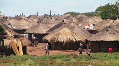 Long-shot of a traditional village or refugee camp in Northern Uganda. Stock Footage