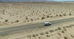 Truck Driving Desert Road Aerial Side Angle Stock Footage