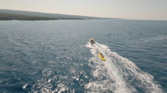 Aerial view of inflatable towable banana tubes ride Stock Footage