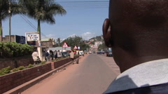 Point-of-view shot over the shoulder of a man traveling along a busy highway in Stock Footage